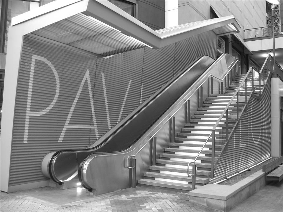 perforated metal screen wall escalator