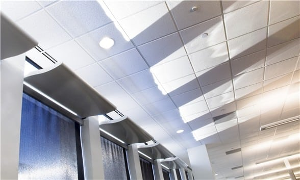 Light Shelf installed over roller shades in an office